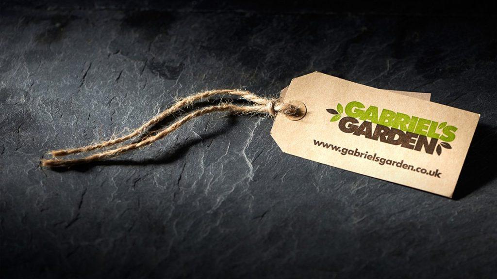A Gabriel's Garden swing ticket on a slate background