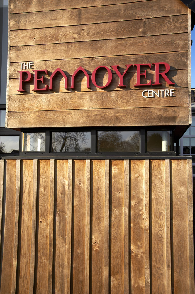 Wooden cladding and external signage for The Pennoyer Centre