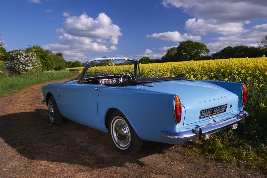1967 Sunbeam Alpine by side of rapeseed oil field