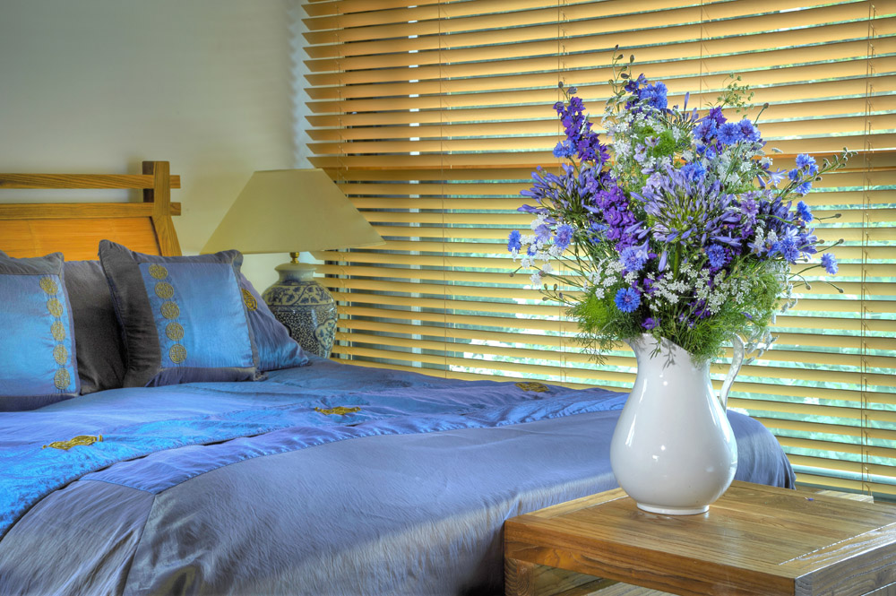 Blue bedroom with blue and purple flowers