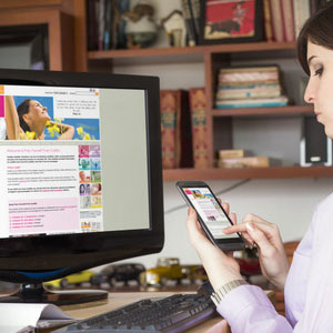 Desktop and mobile being held showing Free Yourself From Cystitis website