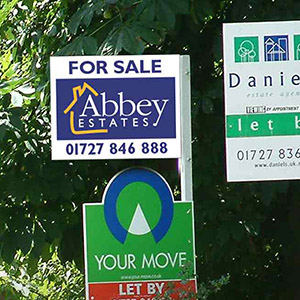 A For Sale sign for Abbey Estate Agents